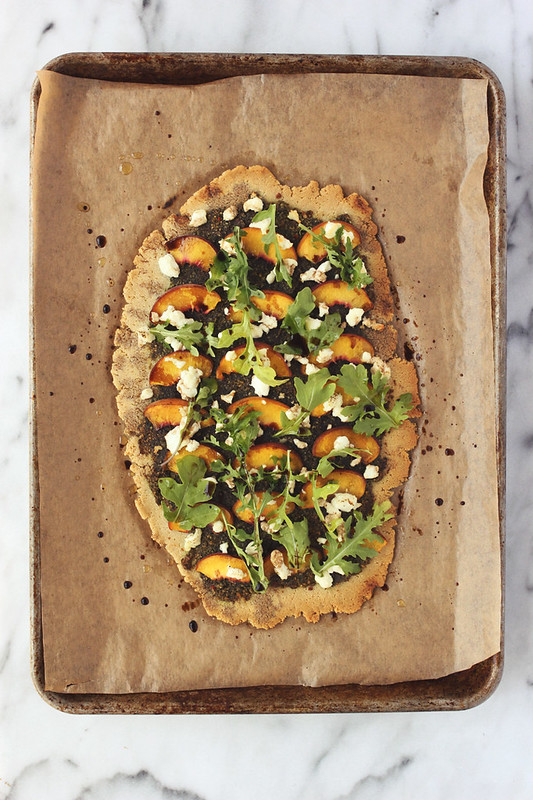 Grain-free Flatbread with Balsamic Basil Pesto, Peaches, Goat Cheese and Arugula