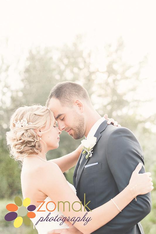 Zo-Mak Photography captures a romantic embrace during bridal portraits.