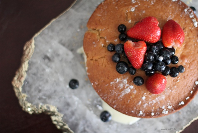 Buttermilk cake with marscapone cream and wine berries top by little luxury list