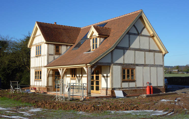 New buildings built in traditional architecture style for Oak framed house designs