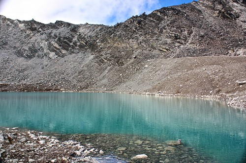 Glacial lake near Kongma La pass (notice the flags near the top middle of the picture?