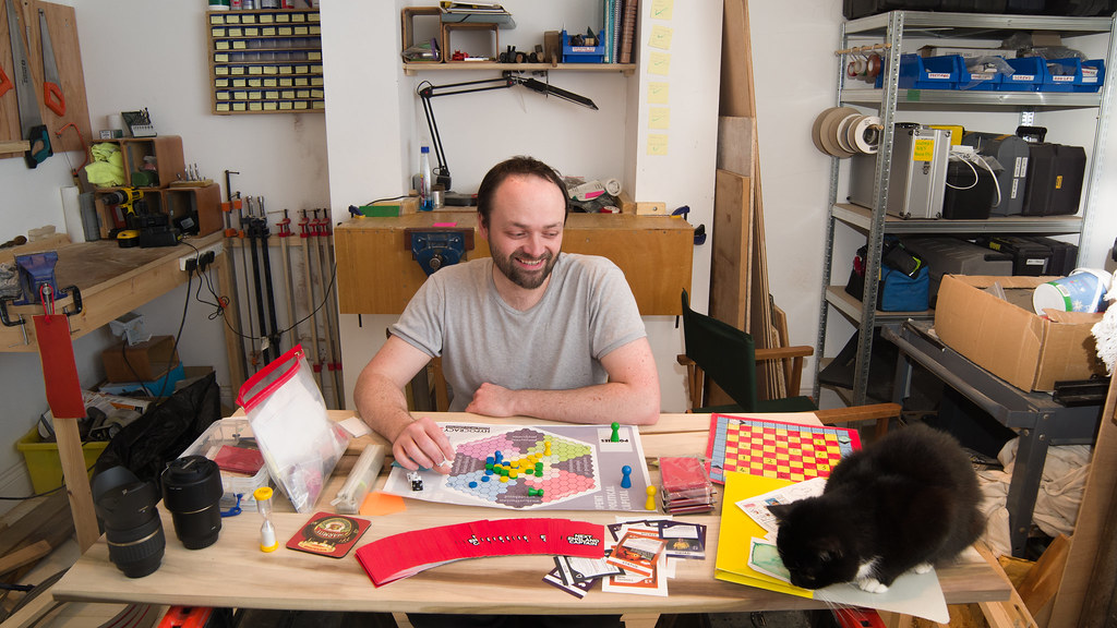 A photo of J-P in his workshop, with a cat.