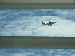Plane framed by Windows at Heathrow