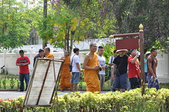 The mixed monks- civilian group assemble at the museum gates