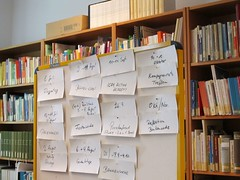classroom(0.0), inventory(0.0), shelving(1.0), shelf(1.0), furniture(1.0), book(1.0), library(1.0), archive(1.0), public library(1.0),