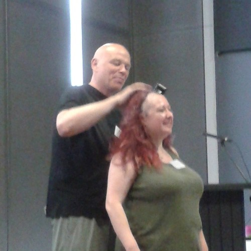 Theresa Derwin getting her head shaved by Simon Clark for breast cancer.