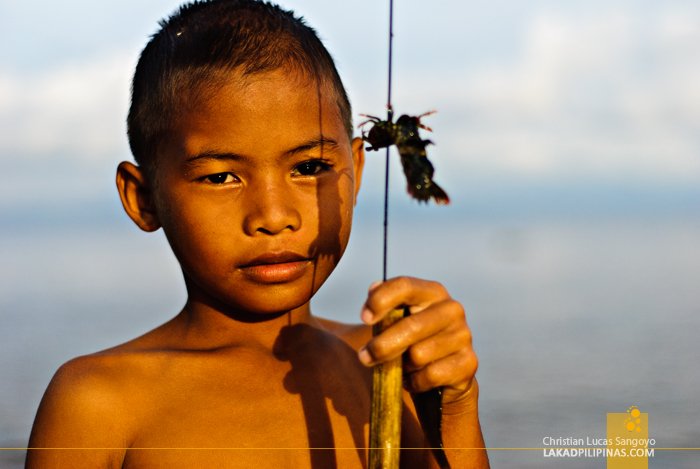 A Kid with a Catch at Tambobong Beach in Dasol, Pangasinan