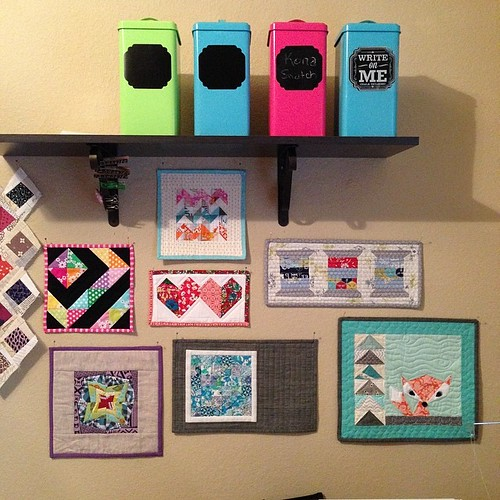 202:365 The wall of mini quilts above my sewing machine is coming along nicely.