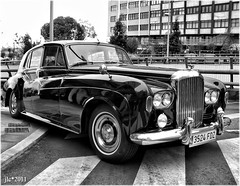 bentley s1(0.0), rolls-royce phantom(0.0), convertible(0.0), automobile(1.0), rolls-royce(1.0), rolls-royce phantom vi(1.0), rolls-royce phantom v(1.0), bentley s2(1.0), vehicle(1.0), rolls-royce silver shadow(1.0), automotive design(1.0), rolls-royce silver cloud(1.0), monochrome photography(1.0), antique car(1.0), sedan(1.0), vintage car(1.0), land vehicle(1.0), luxury vehicle(1.0), black-and-white(1.0),