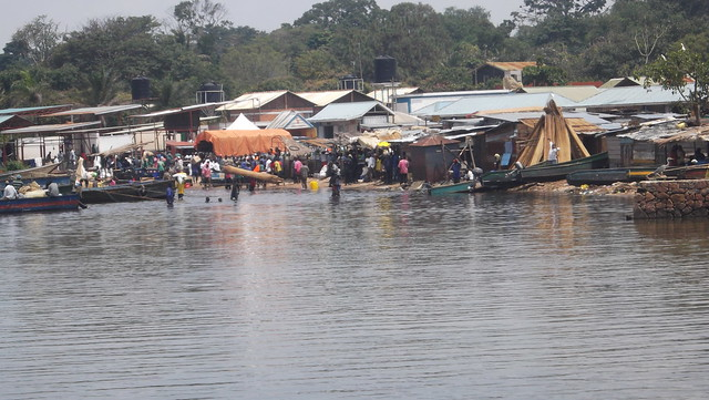 There are numerous traders operating businesses at Kasenyi landing site, on Lake Victoria. Their wooden and metallic structures placed about 50 metres into where the lake waters used to be. Credit: Joshua Kyalimpa/IPS