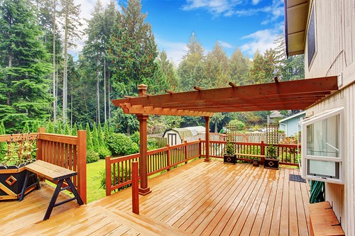 pergola on wooden deck with trees
