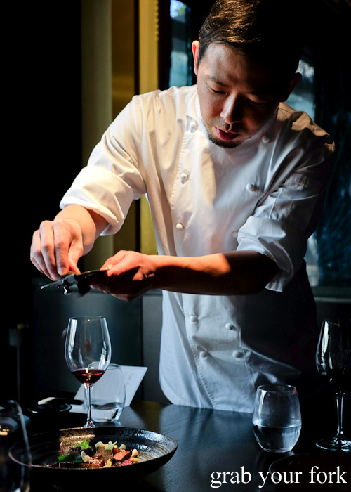 Chef Chase Kojima shaving truffles over wagyu at Sokyo at The Star, Pyrmont