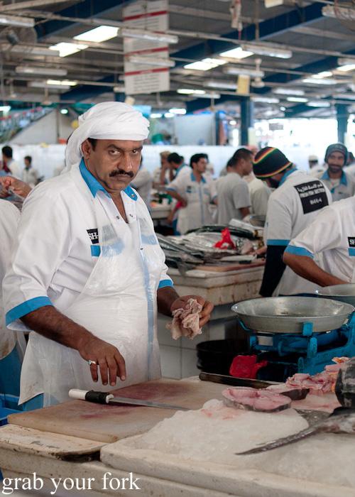 Fishmonger at Dubai Fish Market in Deira