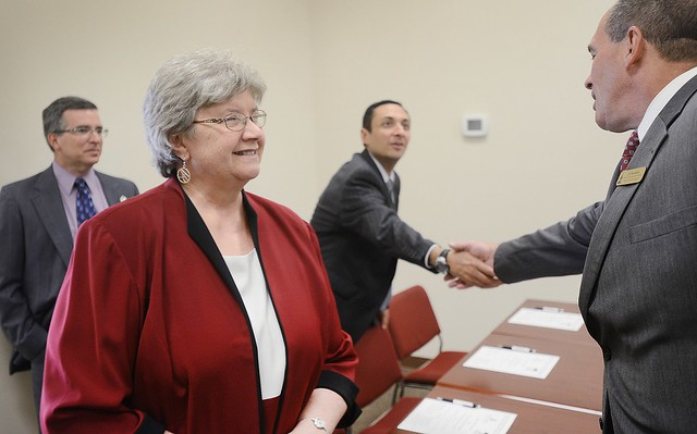 Dr. Peter Bailey, Vice President of External Affairs at Wilmington University, greets Joan Baillie of SCC and her colleagues at the signing of the BSN agreement.