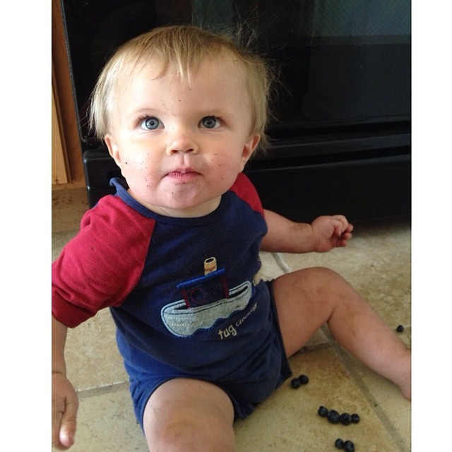 Oh you know mom just looking adorable and pouring blueberries all over the floor.