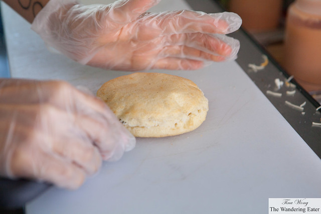 Splitting the arepa in half