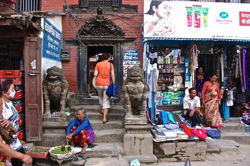Olga looking for water in a Kathmandu shop
