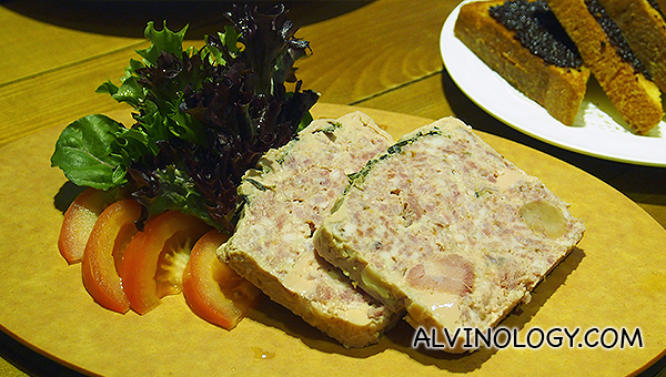 The Pork Terrine - comprises two slabs flavoured with herbs and spices, accompanied by a side of walnut salad and slices of warm brioche baked fresh daily  (S$15)