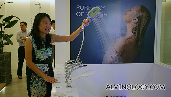 A Grohe staff member demonstrating the Rainshower Icon shower set