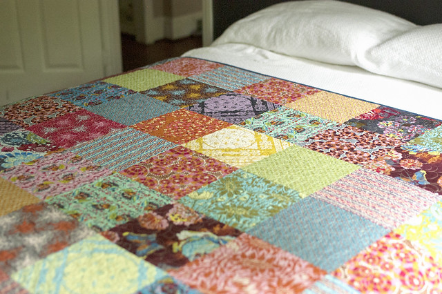 AMH Patchwork spread out on bed