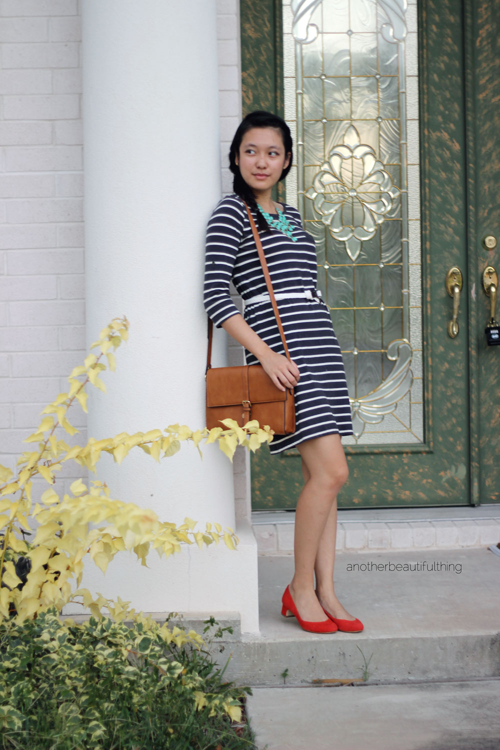 T-shirt dress with brown satchel and flame red pumps