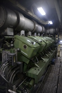 One of the Coast Guard Cutter Healy's four diesel/electric engines provides power to the vessel as it leaves the port of Seward, Alaska, Aug. 8, 2014. The Healy's engines can generate up to 30,000 horsepower and allow the vessel to smash through thick Arctic ice. U.S. Coast Guard photo by Petty Officer 1st Class Shawn Eggert.