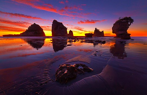 ocean new travel trees sunset sea vacation sky cloud seascape reflection beach nature water beautiful rock clouds landscape sand rocks colorful long exposure outdoor stack zealand will nz southisland seastack shieh lightvision motukiekie