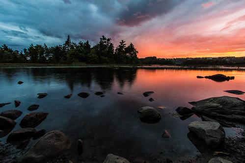 sunset reflection water rocks novascotia ns halifax dartmouth shubiepark lakemicmac helenaisland