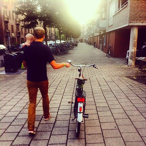 Father and son, walking with a #dutchbike #daddyday #papadag #growingupinholland #amsterdam #cycling #cyclechic #bicicleta #father #childcare