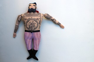 big man with lady tattoos