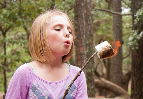 Madelyn Morrissey blows on a roasted marshmallow near the George Washington/Jefferson National Forest. (Courtesy Adrian Roth)