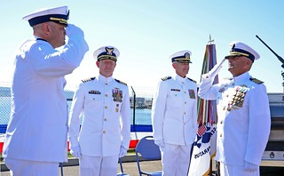 With a salute, Capt. Daniel W. Clark (right) passes his command of Coast Guard Port Security Unit 313 to Cmdr. James R. Hotchkiss (left) during a change of command ceremony held at Naval Station Everett, Sept. 20, 2014. The change of command ceremony is a time-honored ceremonial tradition that formally restates the continuing authority of that command and transfers total responsibility and authority from one individual to another. (U.S. Coast Guard photo by Petty Officer 3rd Class Amy Nuckolls.)