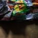 "Recycling - Collection of empty bags of savory-snacks for Weaving ""Pomegranate, Mirror - Improvisation 2""-  leere Salzgebäcksackerln für Weben ""Granatapfel, Spiegel"" - Chips, Erdnußlocken, Kinder Pingui,  Pom-Bären, Sing-Sing, Backerbsen, Zigeunerräder..."