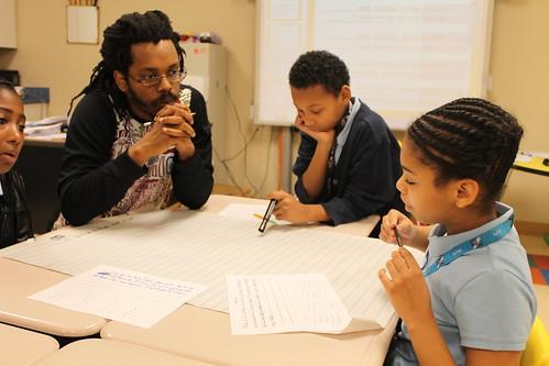 Bomani brings Hip Hop poetry to Scholars K-8