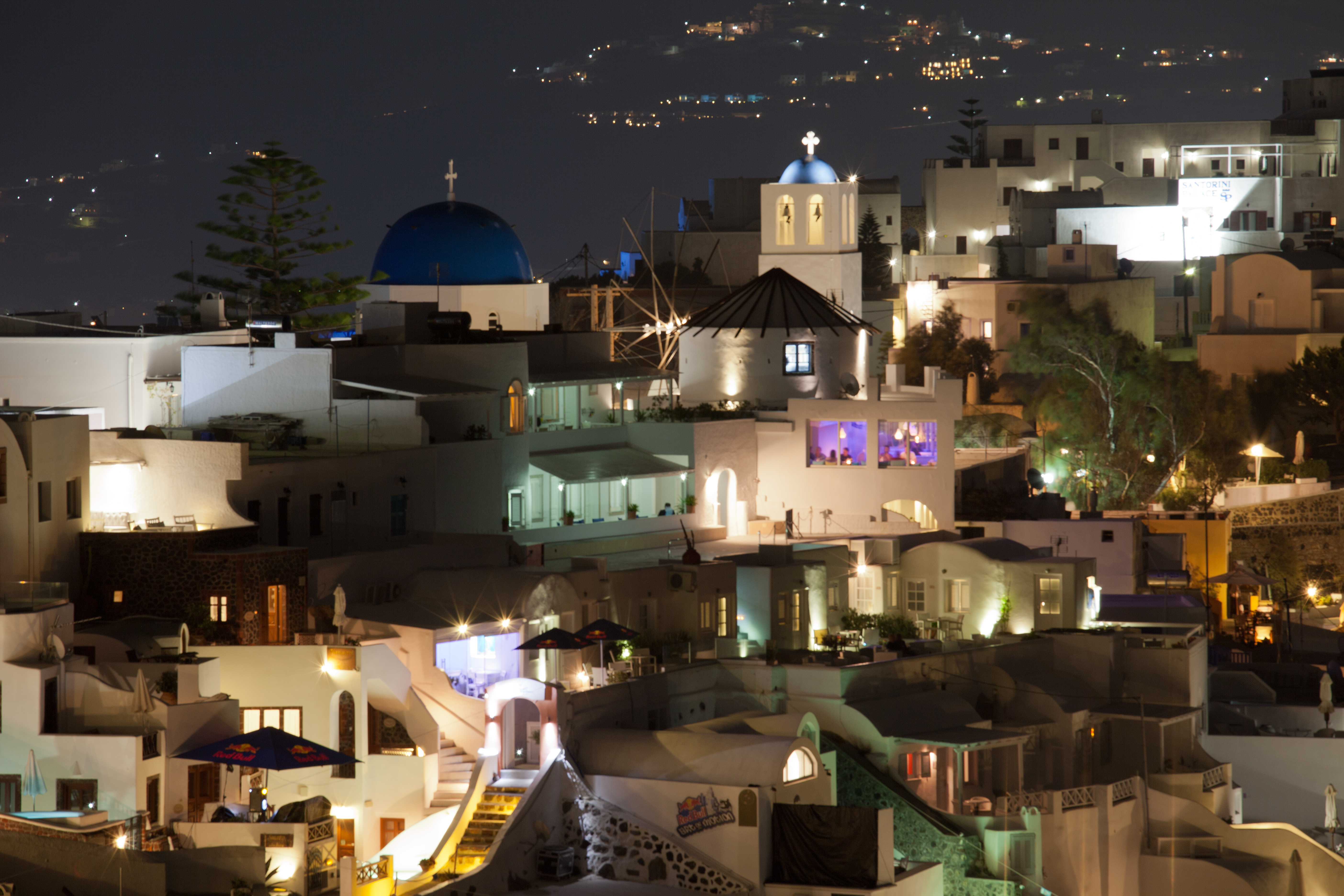 Town of Firostefani, Santorini, Greece at night with blue domed church