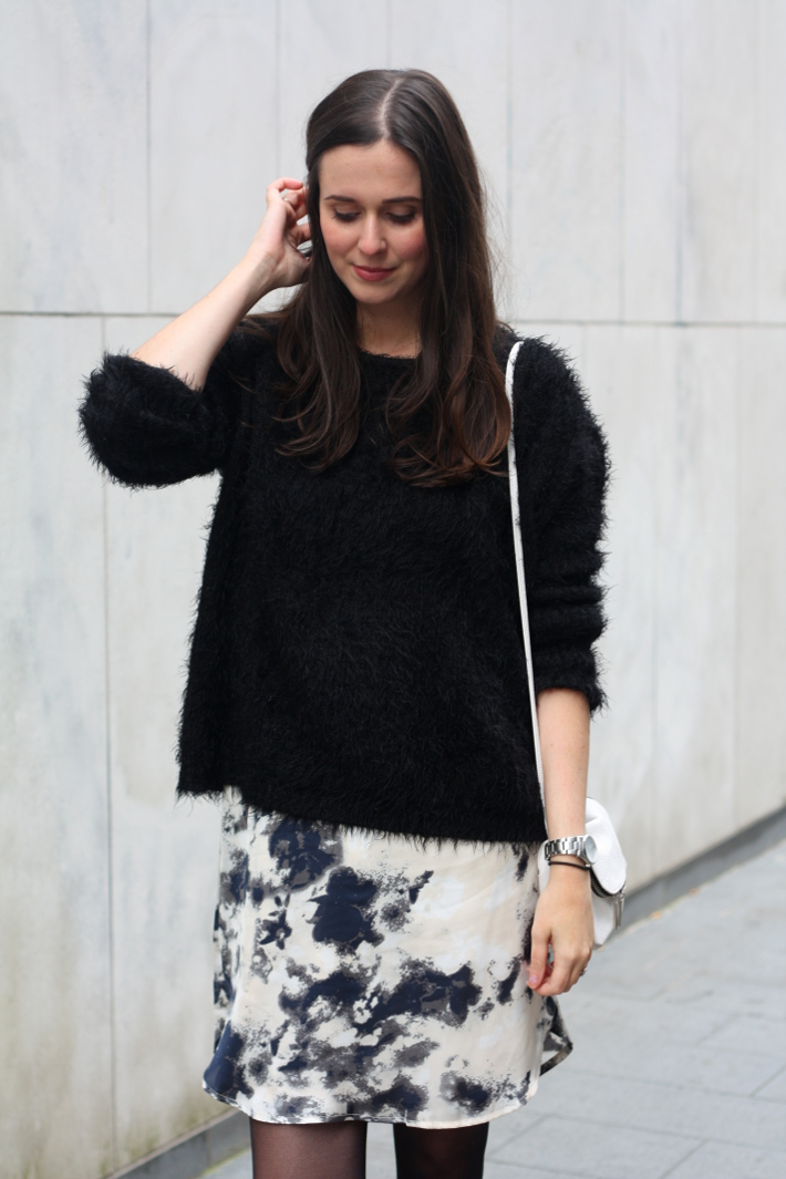 black fluffy sweater white purse high low dress