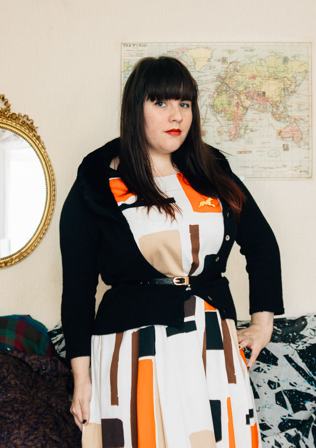 retro print dress and black collared cardigan