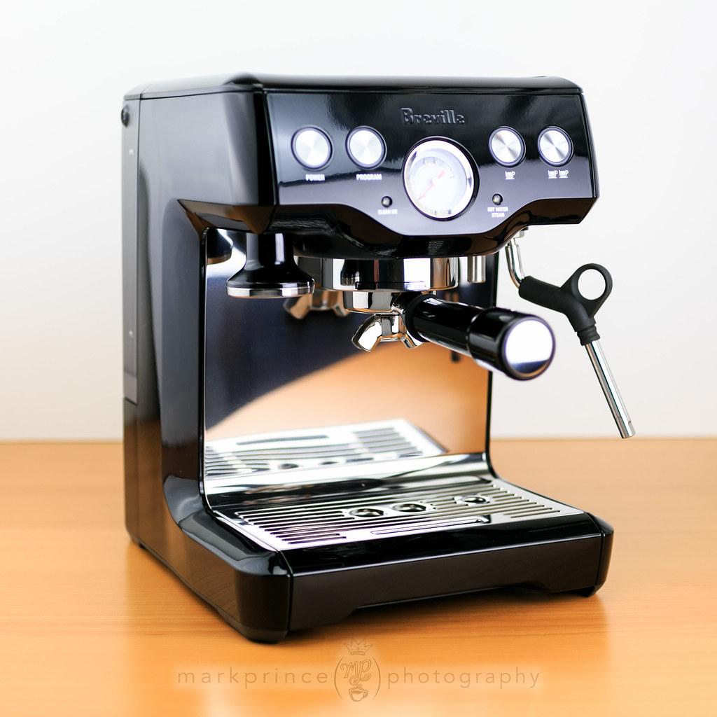 the breville infuser espresso machine in piano black