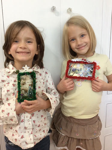 They designed their own shadow boxes...picked the card, glittered the boxes, and picked out the embellishments. They are very proud of what they created...with a little help from Ma.