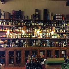 Endless bottles at our local wine and scotch shop. #France - Photo of Trémolat
