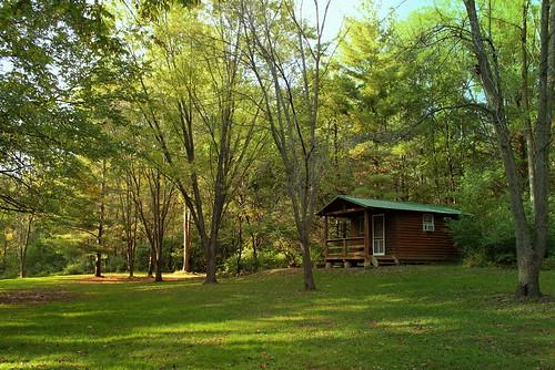 peace dappledsunlight cabininthewoods jeffersoncountypark fairfieldiowa campinginthewoods peaceinnature greentreesandgrass