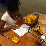 Kamari working on a robot kit