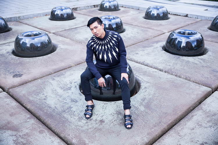 Bryanboy wearing a Neil Barrett black lightning bolt sweater