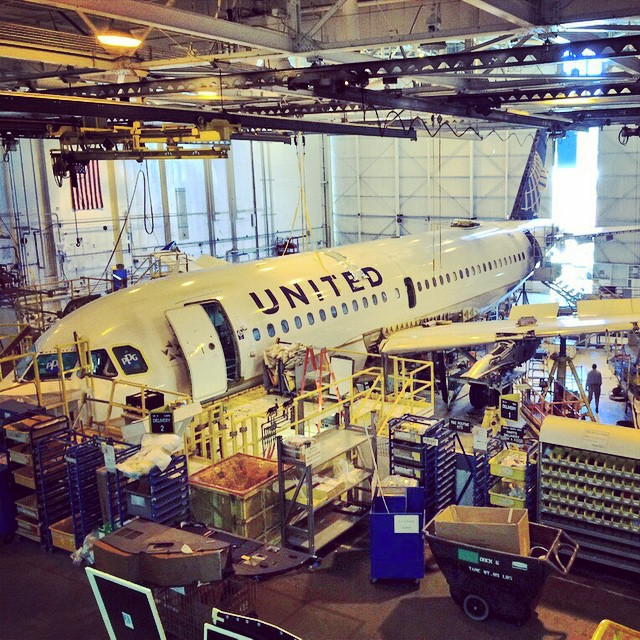 A319 undergoing heavy maintenance #sfofamilyday2014