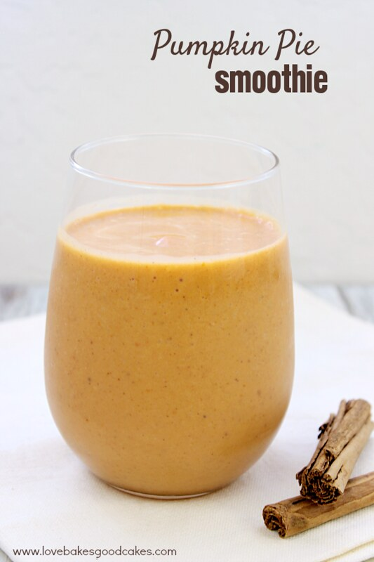 Pumpkin Pie Smoothie in a clear glass with cinnamon sticks.