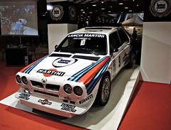 race car, automobile, lancia, vehicle, performance car, automotive design, auto show, world rally car, land vehicle, luxury vehicle, supercar, sports car,