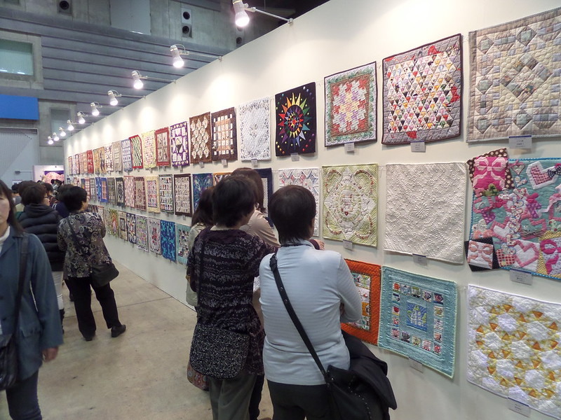 One wall of small quilts