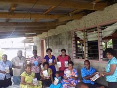 Our BSSP CAP Editor Mere (right) distributing scriptures in Nayavu village, Wainibuka.