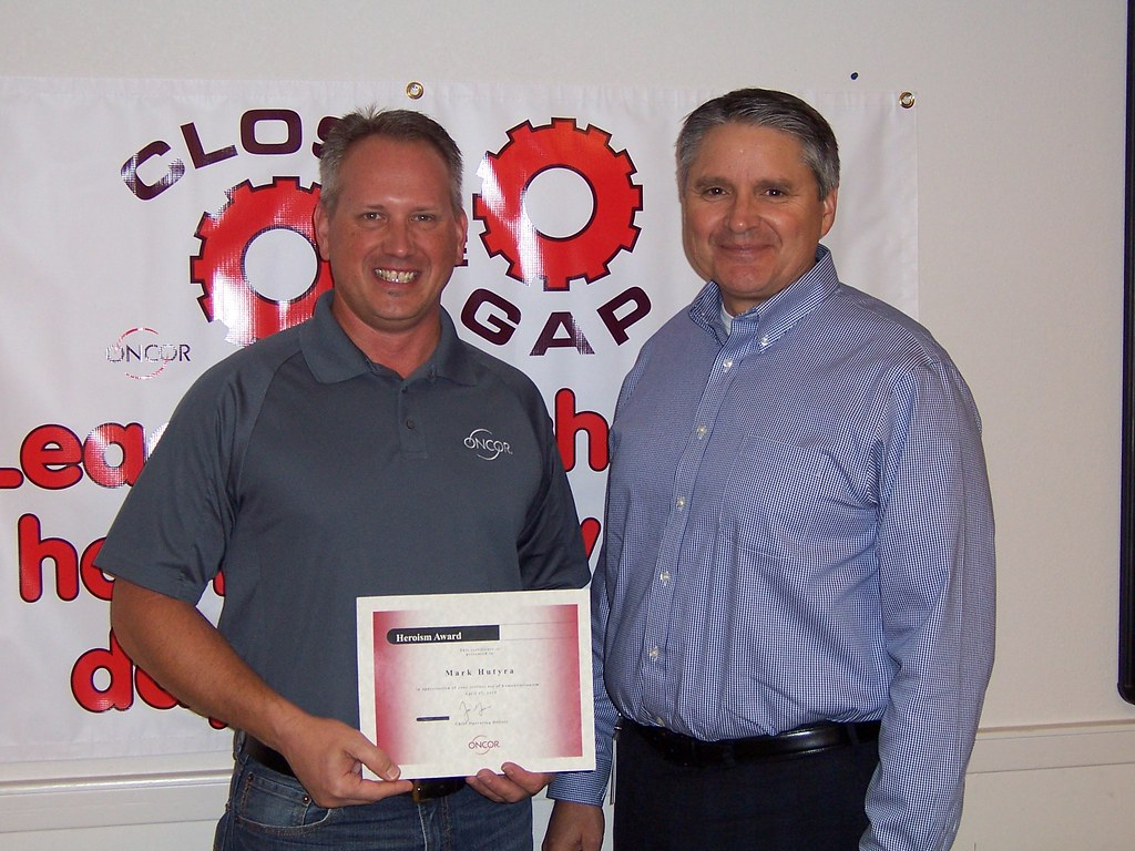 Mark Hutyra accepts Safety Heroism Award from COO Jim Greer
