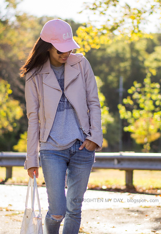 pink cap, lilac leather jacket, gray tee, distressed jeans